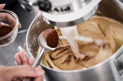 Adding cocoa powder Royalty Free Stock Photos