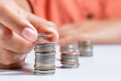 Adding coin Royalty Free Stock Photography