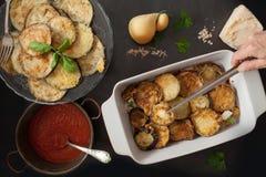 Adding Fried Eggplant Slices To Parmigiana Royalty Free Stock Photo