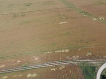 Adding herbicide tractor on the field of ripe wheat. View from above. Royalty Free Stock Images