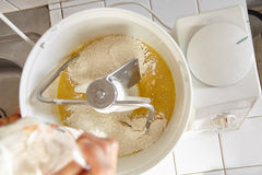 Adding ingredient to batter machine. To make bread dough Stock Photos