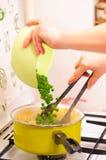 Adding Ingredients Stock Photo