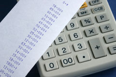 Adding machine. Calulator keypad and paper roll Royalty Free Stock Photos