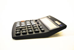 Adding machine - calculator. Black calculator on white background stock photography