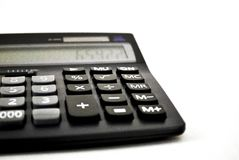 Adding machine - calculator. Black calculator on white background Royalty Free Stock Image