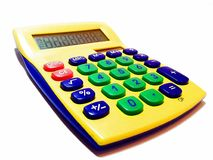Adding machine - calculator. Yellow calculator on white background royalty free stock photography
