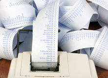 Adding Machine and Long Roll of Paper Royalty Free Stock Photo