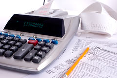 Adding Machine with tax forms stock image