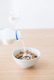 Adding milk to cornflake Stock Image