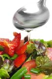 Adding oil to salad Royalty Free Stock Photography