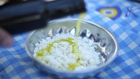 Adding olive oil to cheese stock video footage