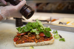 Adding pepper to sandwich Royalty Free Stock Photography