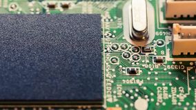 Adding samples. Chips on a electronics printed circuit board stock video