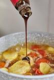 Adding sauce Stock Photos