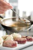 Adding sause Royalty Free Stock Photo