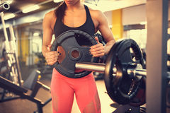 Adding weights on barbell, concept Stock Photography