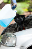 Adding windshield washer fluid on a car Royalty Free Stock Photos