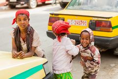 Three small orphan street kids playing and laughing on a quite c royalty free stock photos