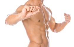 Additifs de bodybuilding et de produit chimique : pilules colorées par participation forte belle de bodybuilder d'isolement sur l photographie stock