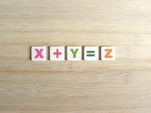 Addition in algebra. Addition concept in algebra X+Y=Z on wood background royalty free stock images