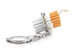 Addition concept with cigarettes and handcuffs Royalty Free Stock Photos