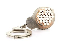 Addition concept with cigarettes and handcuffs Stock Photography
