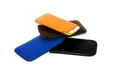Addition mobile phones. And in different colored covers Stock Images