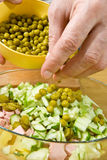 Addition of peas in salad. Addition of tinned peas in salad Royalty Free Stock Photos