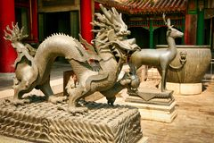 Bronze statues of the dragon and deer in the Forbidden City. Beijing royalty free stock photo