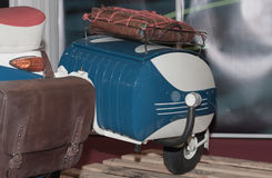 Additional luggage on electric scooter, indoor photo. Royalty Free Stock Image