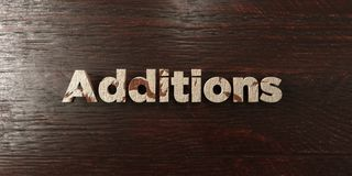 Additions - grungy wooden headline on Maple  - 3D rendered royalty free stock image Royalty Free Stock Photo