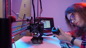 Additive technology and 3D printing concept. Woman Architect Using 3D Printer