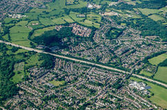 Addlestone, Surrey - Aerial View. Aerial view of Addlestone in Surrey with the M25 motorway cutting the residential areas in two with Row Town to the upper part Stock Photography