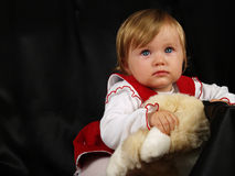 Addorable little baby girl. In studio with toy Royalty Free Stock Photos