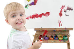 Addorable Toddler Boy Painting At Easel Stock Photo