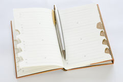 Address book with ballpoint. Address book with silver pen isolated on white background Stock Images