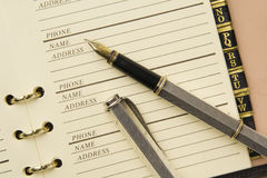 Address book and fountain pen Stock Images