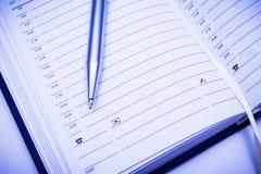 Address book & metal pen Royalty Free Stock Photography