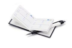 Address book and pen. Mini address book and pen on white background Stock Photos