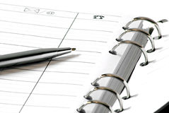 Address book and silver pen Royalty Free Stock Image