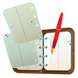 Address book with two flying sheets and red pen Royalty Free Stock Photos