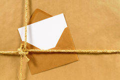 Address label or delivery card, brown paper parcel background, copy space Royalty Free Stock Photography