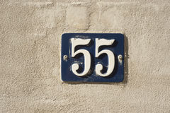Address number 55. Number 55 on the wall Royalty Free Stock Images