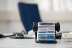 Address register. Rotary card file (address register) standing on table in office Royalty Free Stock Photography