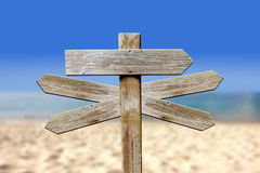 Addresses of wood on the beach. Sign Stock Image