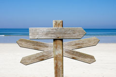 Addresses of wood on the beach. Sign Stock Photos