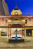 ADE Arcade Facade Front. Entrance and perspective through historic architectural building of Adelaide shopping street Rundle mall with fountaine in the front at Royalty Free Stock Photos