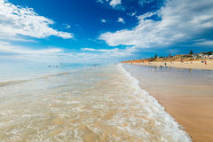 Moana Beach, South Australia. Adelaide, Australia - December 19, 2015: People relaxing and having fun at Moana Beach on a bright warm summer weekend. Moana is a Royalty Free Stock Photo