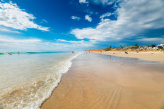 Moana Beach, South Australia. Adelaide, Australia - December 19, 2015: People relaxing and having fun at Moana Beach on a bright warm summer weekend. Moana is a Stock Images