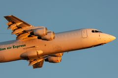 Australian Air Express National Jet Systems British Aerospace 146-300 aircraft VH-NJF taking off from Adelaide Airport at sunset royalty free stock photos
